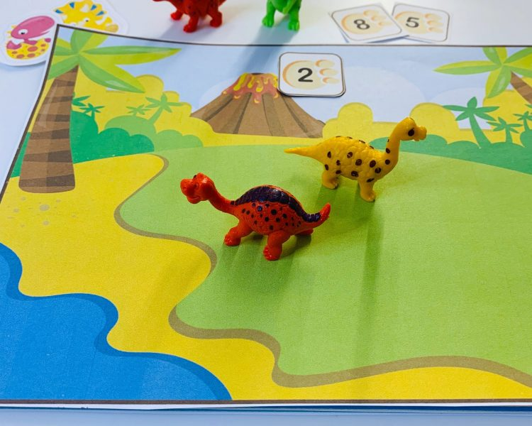 dinosaurs-toys-on-counting-mats